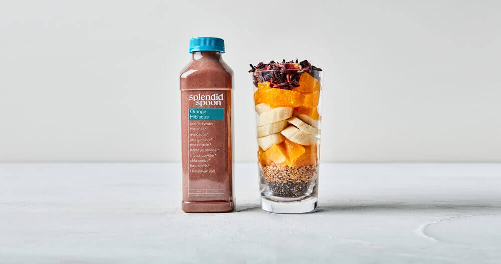 Bottle of Orange Hibiscus Smoothie and glass with ingredients