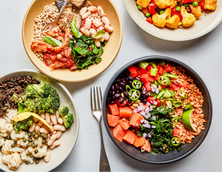 Four Soup & Grain bowls with their ingredients on the side
