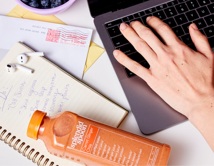 Woman working with Smoothie bottle on her desk