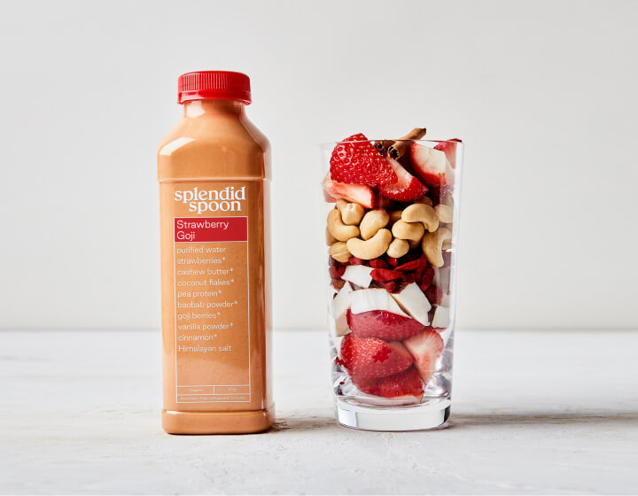 Strawberry Goji Smoothie and glass with raw ingredients