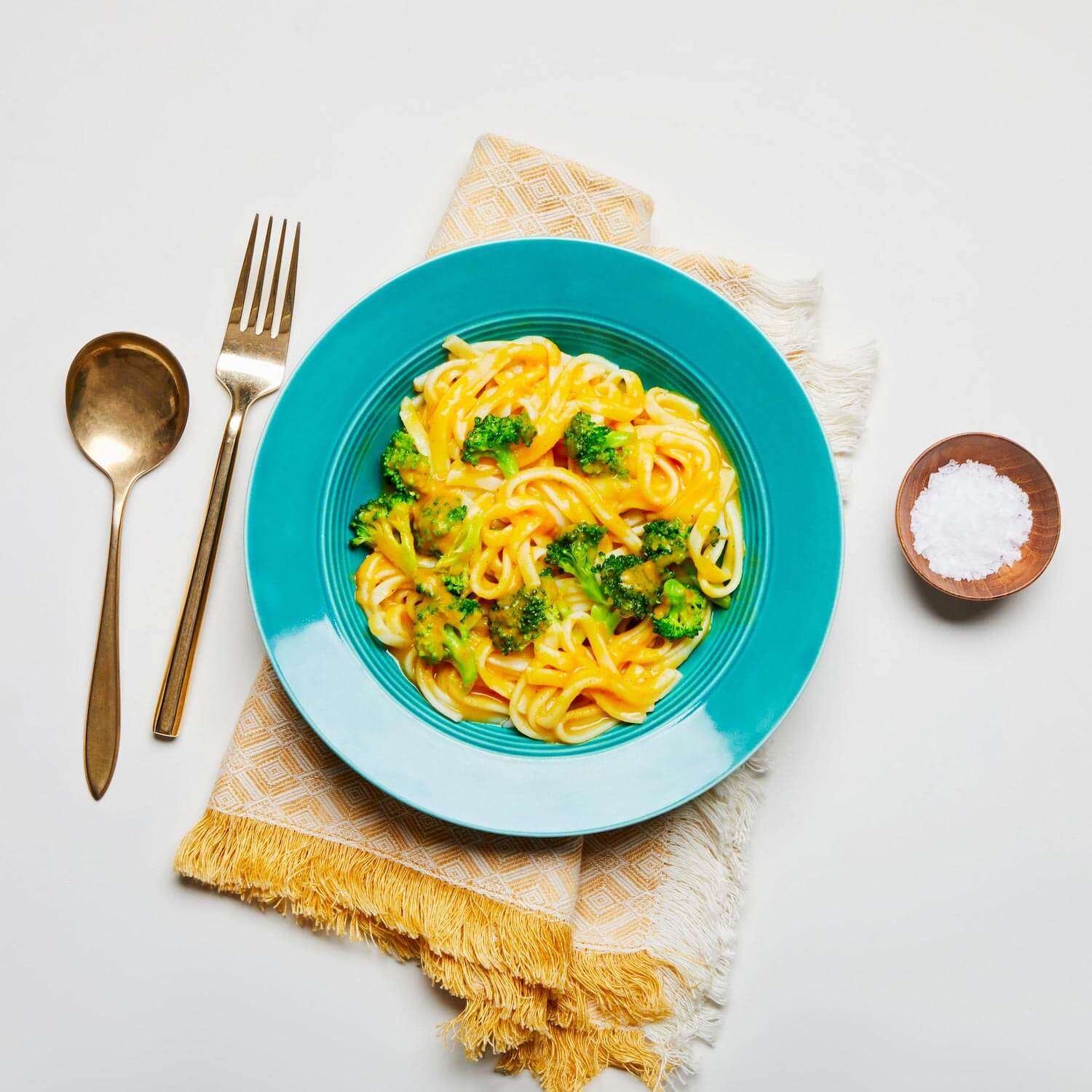 Creamy butternut squash noodles on a plate with a napkin.