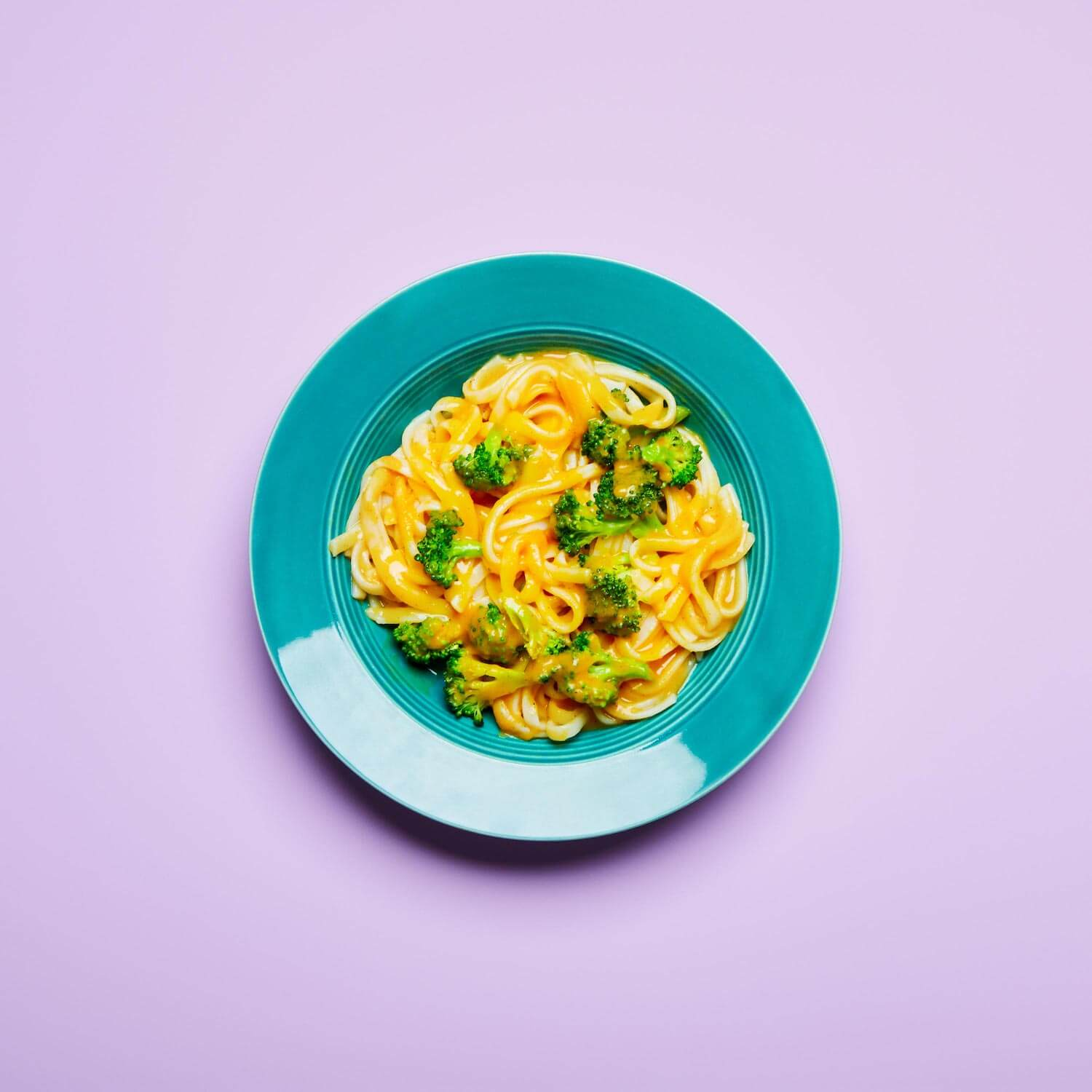 Creamy Butternut Squash Noodles in a dish on a lilac background.