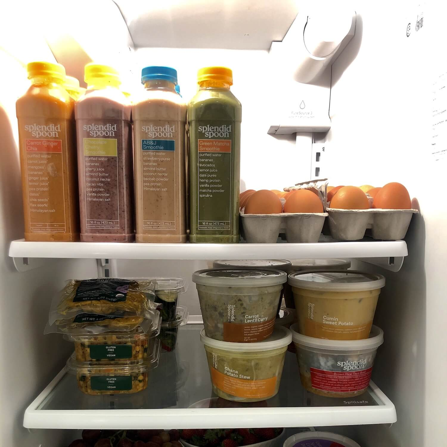 Fridge full of Splendid Spoon smoothies and soup and grain bowls