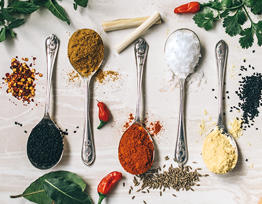 Different spices on spoons
