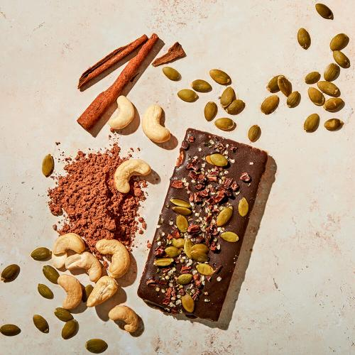 Superfood Chaga Protein Bar with ingredients surrounding it