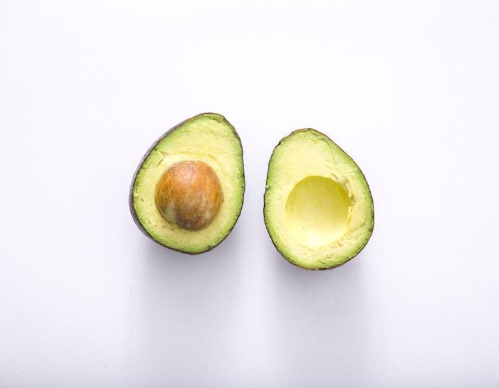 Avocado on green background